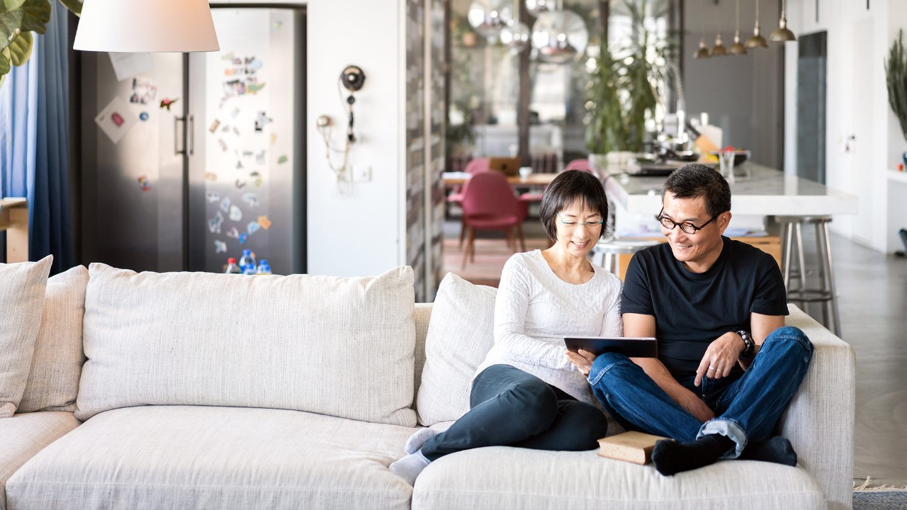 "A couple is using tablet in the living room; image used for ""save for the future"" article."