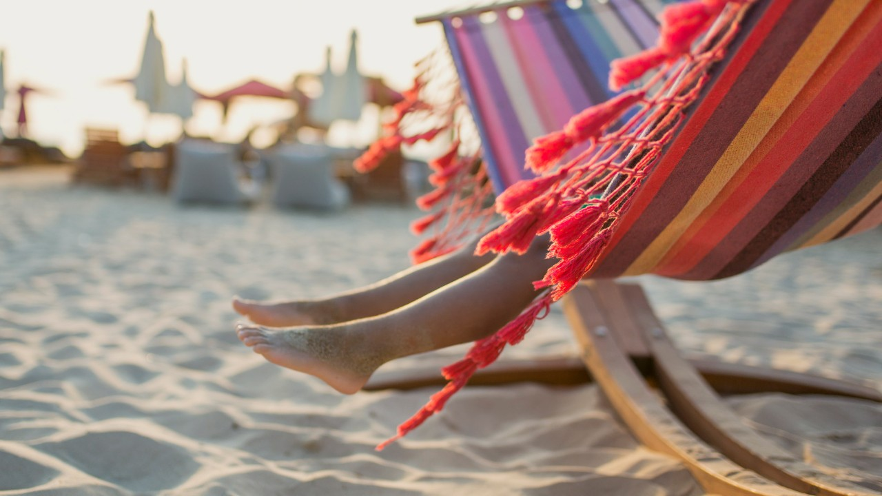 pair of legs on hammock at beach; image used for HSBC Sri Lanka Visa Gold Credit Card