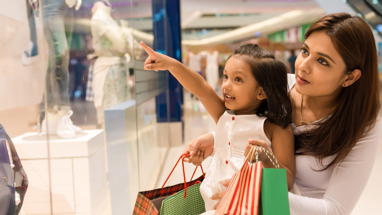 a little girl is happily shopping with her mom; image used for HSBC Sri Lanka Cash Instalment Plan page