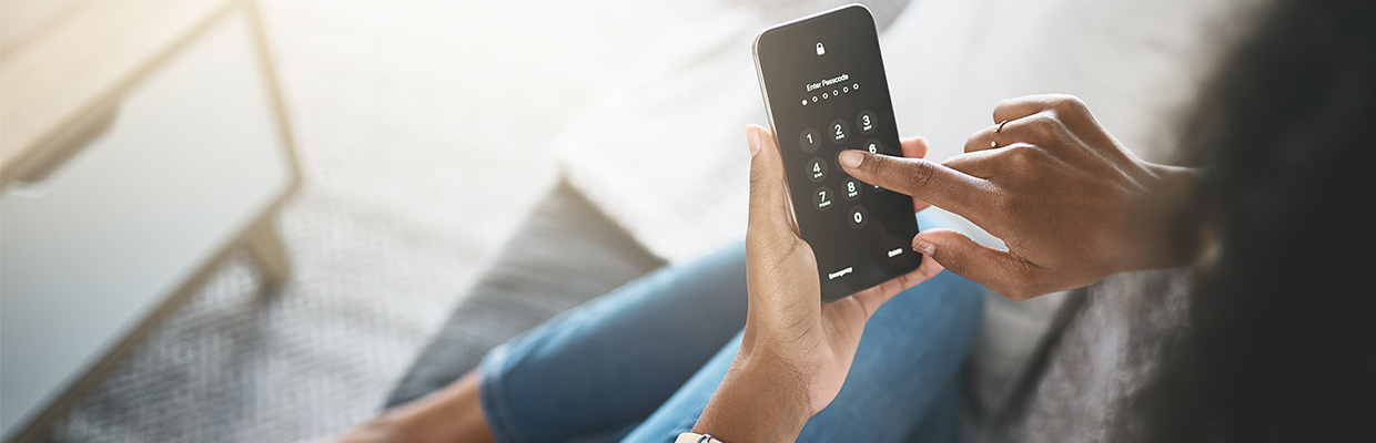 woman is unlocking her mobile with pass-code, image used for HSBC Sri Lanka Ways to Bank Secure Key