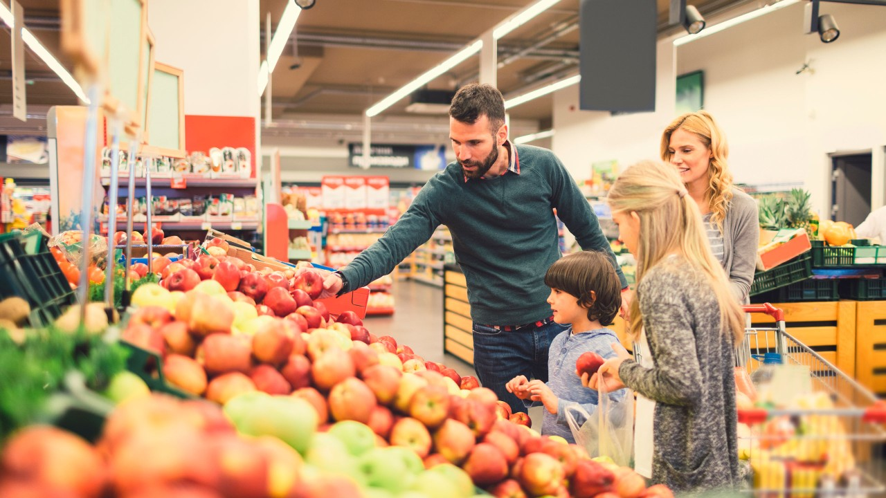 Family shopping at the grocery store; image used for HSBC Sri Lanka Daily Essentials page