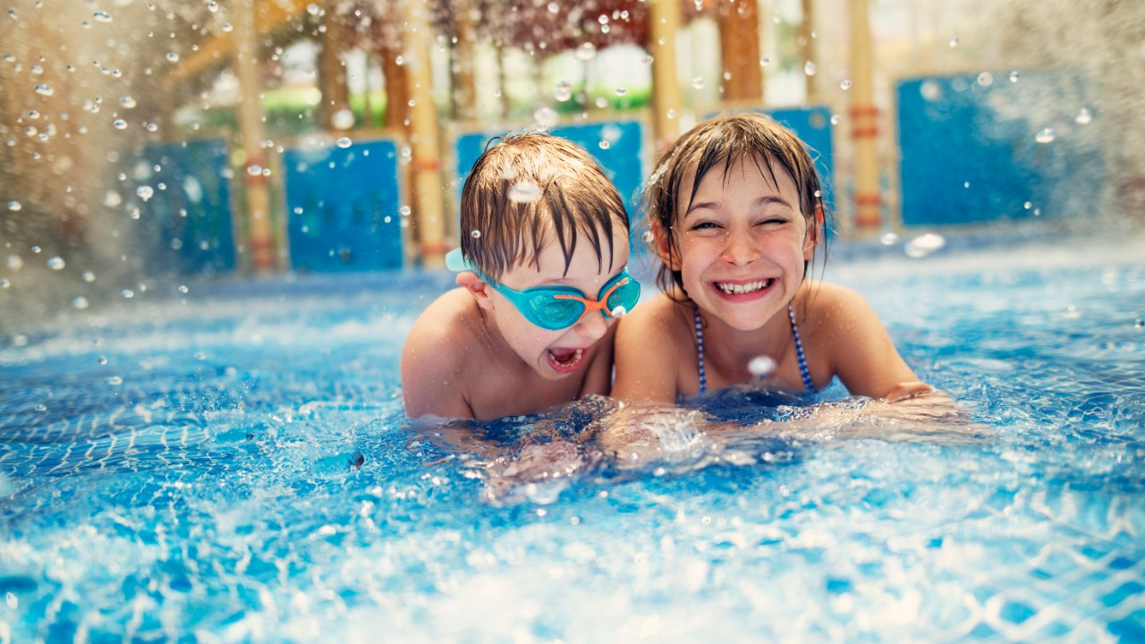 a little girl and a boy playing at water park; image used for HSBC Sri Lanka credit card local holiday offer page.