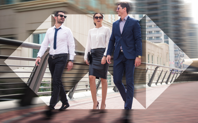 three business executives are walking together and having an pleasant discussion; image used for HSBC Sri Lanka Loans Referral Page
