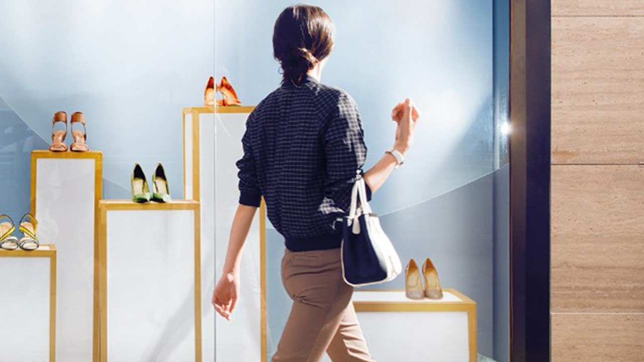 A window shopping woman is looking at shoes display; image used for HSBC Premier Credit Card Landing Page