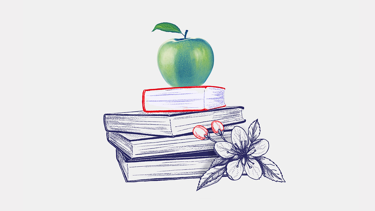an apple on a stack of books; image used for HSBC LK studying abroad page