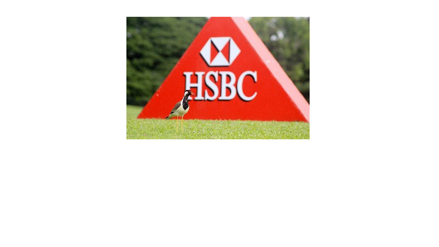 a sign with HSBC logo on the lawn