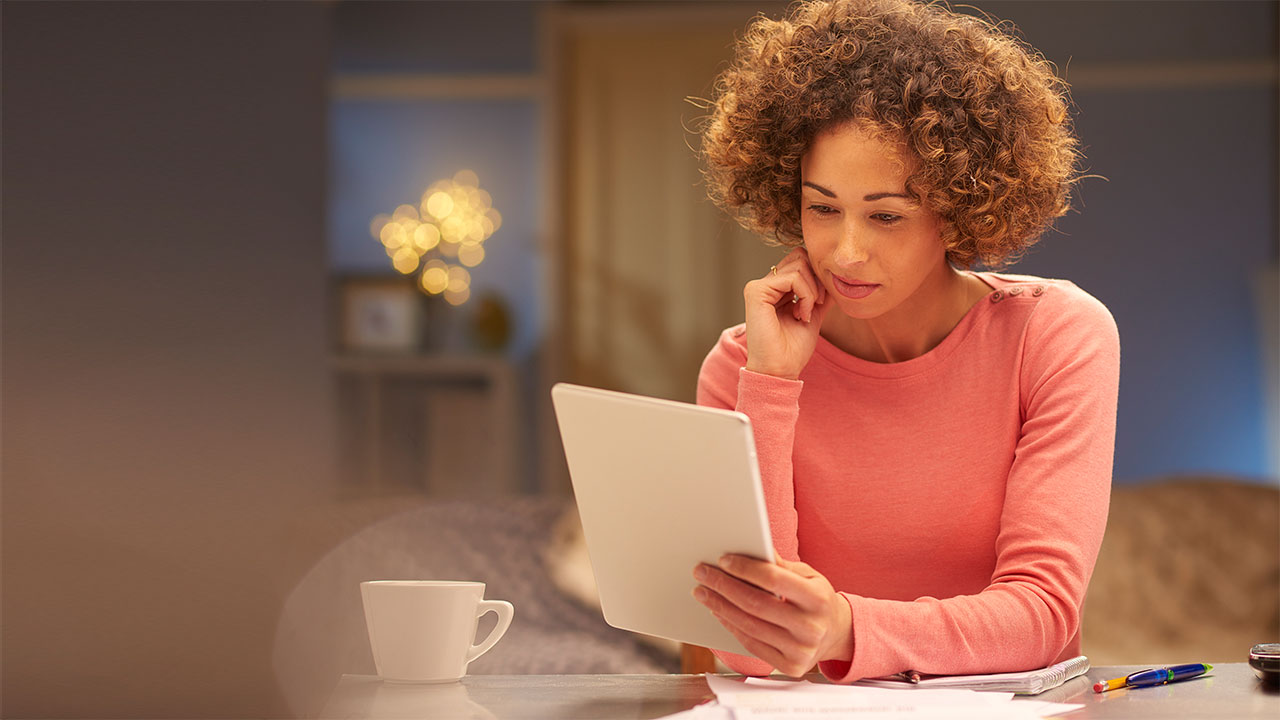 Woman sitting with her Tablet; image used for HSBC LK estatements page.